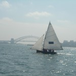 Classic early 20th century skiff sailing on Sydney harbor 2005.