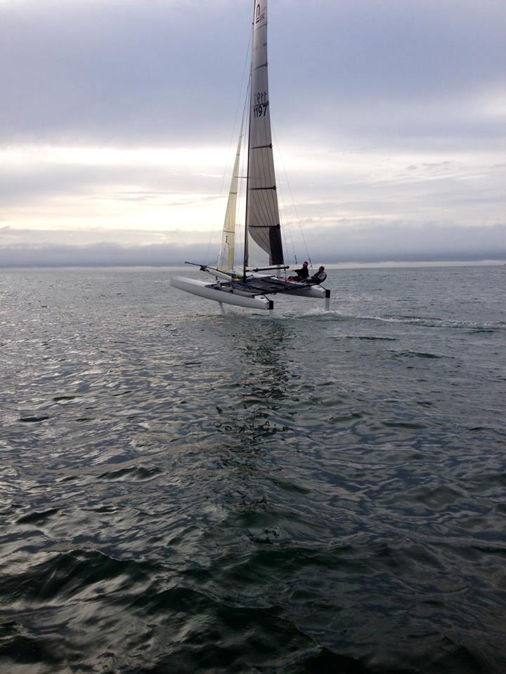 Pegasus-MotionX flying/foiling upwind ahead of the incoming storm. Amazing!