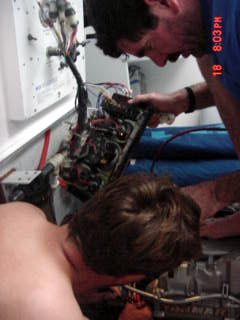 Mark and Nic working on the engine